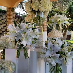 Entrance area to Wedding, a story board of different white flowers in various vases, done by Functions For Africa...