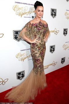 Golden girl: On Saturday night, Katy Perry wore a figure-hugging frock to the Once Upon A Time gala in Los Angeles