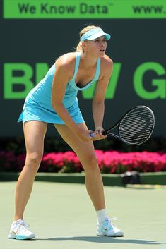 Maria Sharapova Photos - Maria Sharapova of Russia readies to return serve against Andrea Petkovic of Germany during their women's semifinal match at the Sony Ericsson Open at Crandon Park Tennis Center on March 31, 2011 in Key Biscayne, Florida. - Sony Ericsson Open