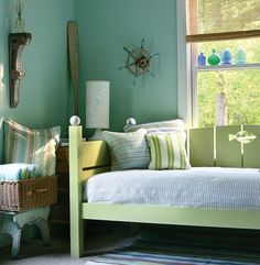 love the blue and green tones in this room. its is calming but still colorful and unique.