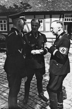Heydrich, Wolff and Himmler. Heydrich disliked Wolff. Schellenberg has a funny description of it in his book.
