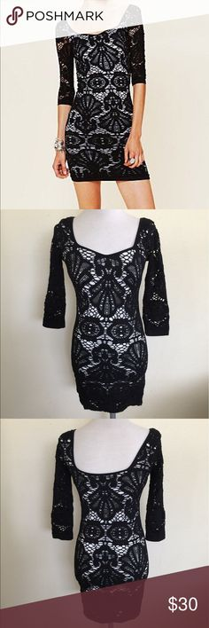 Free People Seamless Medallion Bodycon Dress, M/L Free People Seamless Medallion Bodycon Dress in size M/L. Color is black with a white lining ( sleeves are not lined). Features a beautiful laser cut outer layer with 3/4 sleeves measuring approximately 16.25. Flat lay measure from shoulder to hem is approximately 32. Made from 92% cotton and 8% spandex. In overall very good condition, please look at all photos and ask if you have any questions. Free People Dresses Mini