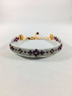 Cool bead loom bracelet in purple, gray and rose gold colors. This beautiful bracelet is made with delica beads and finished with a rose gold ribbon clasps and a two inch extended chain. Can be worn alone or stacked with other bracelets. If you need something larger or smaller or