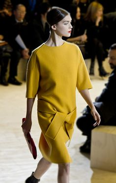 jil sander - one cool minimalistic outfit. love the ballet updo and the red-lipped, porcelain face on the model too.