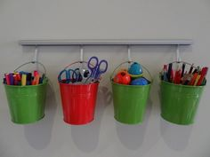 You can keep supplies organized (and off the floor) with dollar store buckets.