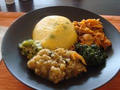 Fungi, with spinach, eggplant, okra and saltfish  Antiguan Food 101 (Part 1) | Try Anything Once