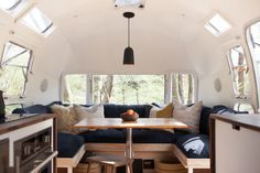 cutest airstream ever. modern caravan vintage airstream renovation dining