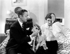 "William Powell puts an icebag on Asta's head in Myrna Loy's hangover scene - Publicity photo for ""The Thin Man"" (1934)"