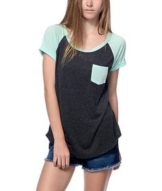A basic tee for anygirl! This Bartlett grey and mint raglan pocket tee is a perfect addition to any casual outfit. The super soft material is a knockout…