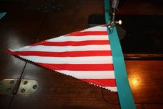 How to make a fabric pennant banner | http://littlevintagetrailer.com/2011/08/how-to-make-fabric-pennant-banner/