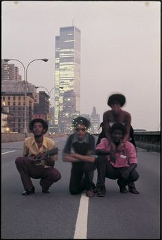 AUGUSTUS PABLO AND FRIENDS IN NEW YORK CITY,  1975. PHOTO © TED BAFALOUKOS