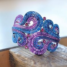 Love the combination of purple and blue stones--inspiration for an amethyst and sapphire birthstone piece