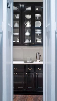glossy black butler's pantry cabinets