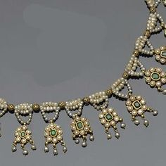 An Indian emerald and seed pearl fringe necklace