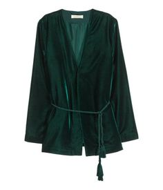 Velvet jacket with long, flared sleeves, a twisted cord tie at the waist and no buttons. Lined.