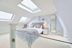 l-shaped loft conversion wimbledon : Modern bedroom by nuspace