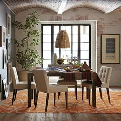 So many pretty things.  The arched brick ceiling, the tufted chairs, the hardwoods and a wonderful rug.