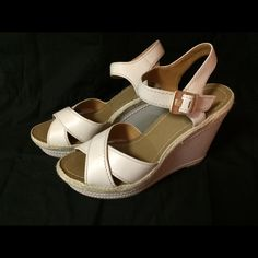 Vince Camuto white leather sandals Almost brand new Vince Camuto wedges. Very fashionable and comfortable. Gold knuckle. Worn only once. No wear and tear, no stains Vince Camuto Shoes Sandals