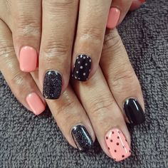 Peach and black nails with glitter and dots