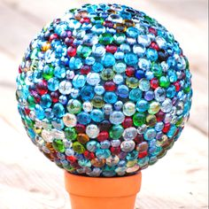 Marble Gazing Ball.  Made with a bowling ball and glass craft jewels.