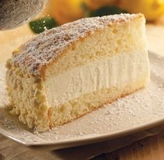 One of my favorite desserts...Olive Garden Lemon Cream Cake! I would add more lemon in the batter or in the filling. If you add more lemon juice in the filling compensate with a little extra powdered sugar. But it was delicious!!