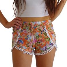 Orange Floral Pom Pom Shorts These floral shorts are adorable and so girly. They feature an elastic waist with tie, and cute pom pom trim. Brand new with tags. Shorts