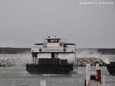 With waves crashing in the background, the Washington Island Ferry returns to Northport Pier in Door County, Oct. 30, 2012. The high waves and choppy water were a result of the western edge of Super storm Sandy skirting Northeast Wisconsin. My Ride Home.