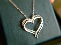 Heart pendant with CZs set in sterling silver plated with platinum