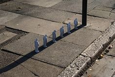 Cement Eclipses by Isaac Cordal http://restreet.altervista.org/gli-schiavi-del-cemento-di-isaac-crodal/