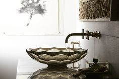 Smoky-hued glass adds mystery and radiance to this bathroom in the form of this Briolette Sink.