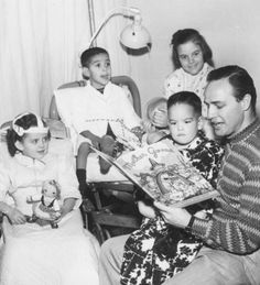 Marlon reading to kids in hospital