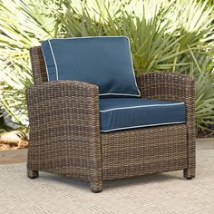 Lawson Wicker Chair | Relax in this style with this casual-chic lounge chair, designed to make downtime as comfortable as it is fashionable. Deep cushions and ample arm space invite you to relax, while UV- and fade-resistant cushions maintain their stylish hues and supportive shape.