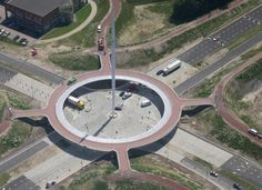 Spectacular New Floating Cycle Roundabout. The bright white 70m tall bridge pylon can be seen from far away. Attached to the top are 24 cables that suspend a large bicycle roundabout, 72m in diameter, that seems to float over a large new junction for motorized traffic. This roundabout can be found in Eindhoven and it is called Hovenring. The exceptional piece of bicycle infrastructure was built to stand out. It is to be the iconic new landmark that signals 'you are entering Eindhoven'.