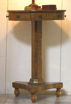 A Neoclassical walnut occasional table circa 1830