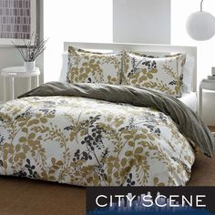 This City Scene Sassafras Cotton 3-piece Duvet Cover Set keeps the bedroom in fashion with its iconic contemporary floral looks. The cotton set reverses to charcoal grey and is machine washable.