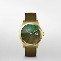 The Slim Olive Leather Watch Marc by Marc Jacobs' gold-tone stainless steel Slim watch features an ombre dial that fades from fresh grass to new olive green, and a strap that's new olive green on one side and fresh grass green on the other.