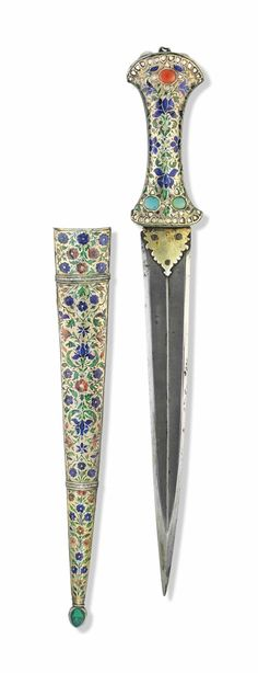 A LUCKNOW ENAMELLED DAGGER (KHANJAR) -  NORTH INDIA, 18TH CENTURY.