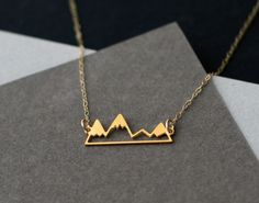 etsyfindoftheday 3 | 6.26.14 theme thursday: golden little golden mountain range necklace by wildthingstudio this simplistic mountain design makes it perfect for everyday wear – it'll go with pretty...