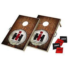 """IH Bean Bag Toss Game   ShopCaseIH.com. This bean-bag toss is an exciting game that packs up easily and is perfect for tailgating or backyard fun! Its two 24"""" L x 36"""" W x 2""""-thick playing surfaces are covered with a full-color, adhesive-backed vinyl print that has a protective clear-gloss laminate. Playing surfaces attach together with Velcro strips and may be easily transported with the integrated handles. #InternationalHarvester #beanbag #toss"""
