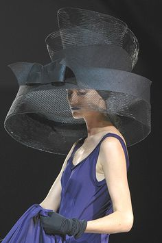 Yohji Yamamoto | detail | spring 2012.  Chapeau or awning?  Hmmmmm. Don't sit behind her in a theater.