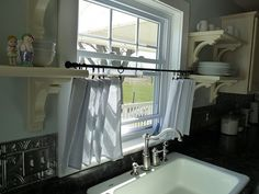 no sew kitchen curtains.  so simple, it's brilliant. I made these for the camper.. Easy!