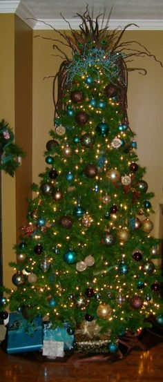 Non-traditional Xmas tree, My Christmas tree is decorated in the teal, brown, bronze, and gold.  I have also thrown in some peacock feathers...