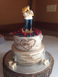 A custom two tiered wedding cake created to look like birch wood with  buttercream made by Cake Creations in Rockford, IL