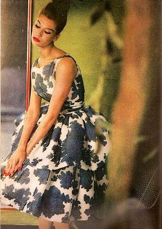 Simone in beautiful print dress with a double-tiered full skirt, photo by Saul Leiter for Harper's Bazaar, July 1955