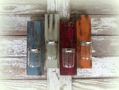 Reclaimed Wood & 4 Mason Jelly Jar Home Decor by Country Akers - Bringing a flair of color to give a unique look for all kinds of purposes..bathroom organizer, vase, candle holder, etc. http://www.etsy.com/shop/CountryAkers