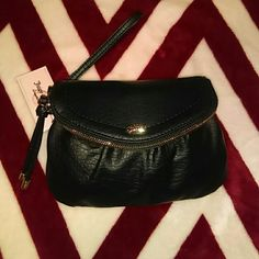 JUICY COUTURE WRISTLET/CLUTCH BRAND NEW. TAGS STILL ATTACHED. ADORABLE. LOST OF POCKES AND CARD SLOTS. NO TRADES. Juicy Couture Bags Clutches & Wristlets