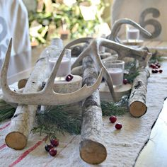 A simple gathering of white birch logs and antlers create a lovely rustic centerpiece for Christmas. Order your Balsam or Fraser Fir clippings & Trees on-line with Hilltop Christmas Tree! Dinning Table Centerpiece, Birch Centerpieces, Antler Centerpiece, Christmas Table Settings, Christmas Tablescapes, Christmas Centerpieces, Christmas Decorations, Holiday Tablescape, Cabin Christmas