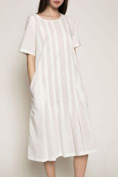 Love Letter Dress in White by Kowtow. Lightweight, straight fit, short sleeve dress with front & back pleats stitched down from shoulder to hip. Side in-seam pockets. 100% premium certified fair trade organic cotton voile.   Love Letter Dress by Kowtow. Clothing - Dresses - Short Sleeve Clothing - Dresses - Casual Manhattan, New York City