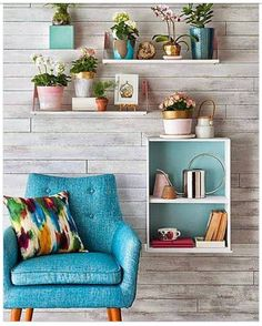 These on the #wall #planters and the #lavish #blue #armchair, look like they belong together.