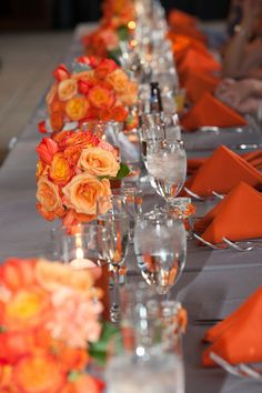 Muted neutral with a pop of bold color. Gray and orange wedding.